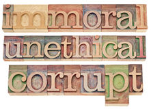 Immoral, unethical, corrupt. Ethics concept - a collage of isolated words in vintage letterpress wood type blocks Royalty Free Stock Images