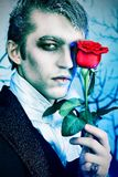 Immortal. Portrait of a handsome young man with vampire style make-up. Shot in a studio Royalty Free Stock Images