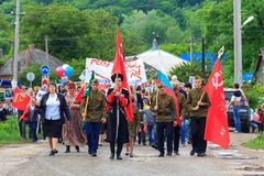 Immortal regiment, Parade on victory day with the participation of schoolchildren and Cossacks. Adygea, Russia - May 9, 2017: Immortal regiment, Parade on Stock Photo