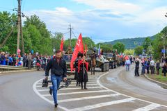 Immortal regiment, Parade on victory day with the participation of schoolchildren, Cossacks and military equipment. Adygea, Russia - May 9, 2017: Immortal Stock Photos