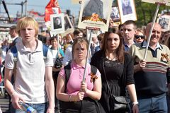 Immortal Regiment - people with portraits of their relatives, participants in the Second World War, on the Victory Day parade. Russia, St. Petersburg 09,05,2016 Stock Images