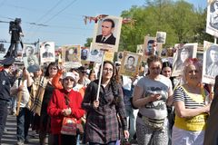 Immortal Regiment - people with portraits of their relatives, participants in the Second World War, on the Victory Day parade. Russia, St. Petersburg 09,05,2016 Stock Photos