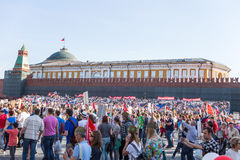 Immortal Regiment procession in Victory Day - thousands of people marching along the Red Square  with flags and portraits in comm Stock Photography