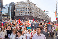 Immortal Regiment procession in Victory Day - thousands of people marching along Tverskaya Street toward the Red Square with flags Stock Photos