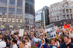 Immortal Regiment procession in Victory Day - thousands of people marching along Tverskaya Street toward the Red Square Stock Photo
