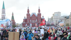 Immortal Regiment procession in Victory Day - thousands of people marching toward the Red Square and Kremlin stock footage