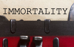 Immortality. Typed on an old vintage paper with od typewriter font Stock Photography