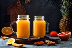 Immune boosting, anti inflammatory smoothie with orange, pineapple, turmeric. Detox morning juice drink. Clean eating royalty free stock photos
