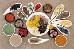 Immune Boosting Foods. Immune boosting healthy superfood selection in porcelain dishes over brown background stock photos