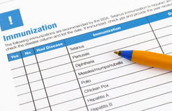 Immunization application form. And ballpoint pen royalty free stock photo