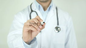 Immunization, Doctor Writing on Transparent Screen. Man writing stock video