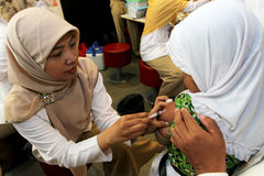 Immunization. Elementary students are following measles immunization in the city of Solo, Central Java, Indonesia stock photography