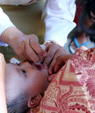 Immunization. Medical personnel are conducting immunization to a baby in the city of Solo, Central Java, Indonesia royalty free stock photos