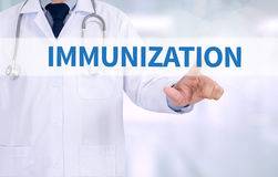 IMMUNIZATION. Medicine doctor working with computer interface as medical royalty free stock image