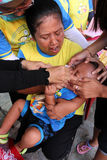 Immunization. Polio immunization for children in a health center in the city of Solo, Central Java, Indonesia Royalty Free Stock Image