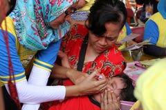 Immunization. Polio immunization for children in a health center in the city of Solo, Central Java, Indonesia Stock Image