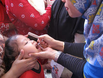 Immunization. Toddlers get polio immunization in a health service posts in the city of Solo, Central Java, Indonesia Royalty Free Stock Images