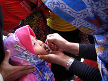 Immunization. Toddlers get polio immunization in a health service posts in the city of Solo, Central Java, Indonesia Stock Image