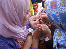 Immunization. Toddlers get polio immunization in a health service posts in the city of Solo, Central Java, Indonesia Stock Images