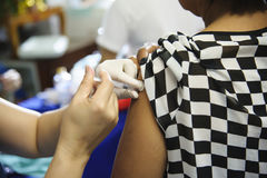 Immunization vaccine injection , doctor inject vaccine to patient arm royalty free stock photos