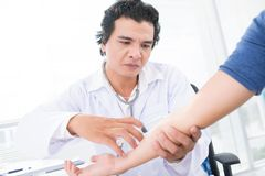 Immunologist. Experienced immunologist giving an injection to the patient Royalty Free Stock Images