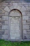 Immured door. Immured door in a stone wall Stock Photo