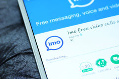 Imo messenger mobile app. Downloading imo messenger mobile app from google play store on samsung tablet Stock Images