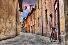 Imola, Bologna, Italy: narrow street in the old town Stock Image