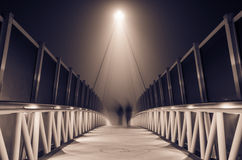 Misty bridge at night Stock Photography