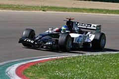 Imola, il 27 aprile 2019: Modello storico PS05 di 2000s Minardi F1 determinato dallo sconosciuto nell'azione durante il giorno st fotografia stock libera da diritti