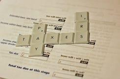 Impôts de salaire Photographie stock