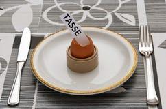 Impôt dans l'oeuf de pâques Photo stock