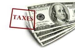 Impôts et argent d'argent liquide Image stock