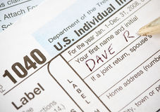 Impôts : Feuille d'impôt de nom d'écriture le 1040 Photos stock