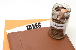 Impôts ou épargne d'impôts Images libres de droits