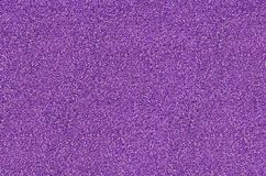 Impact absorbing coatings violet. Violet shock absorbing coatings are made from rubber chips that are used in playgrounds, stadiums, treadmills and sidewalks royalty free stock photography