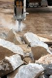 Impact Digger. An impact digger breaking up concrete Stock Image