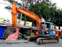 Impact hammer heavy equipment truck at work in a road repair project Stock Photography