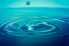 Impact instant of a drop of water Royalty Free Stock Image