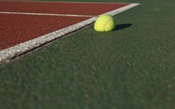 The impact - Tennis ball bouncing. Off the tennis court Royalty Free Stock Photography