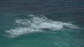 The impact of the waves on the cliffs or shoreline stock video footage