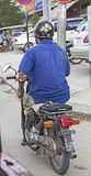 Impaired person driving motorbike in Cambodia Royalty Free Stock Photo
