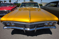 Impala dourada do Lowrider Fotos de Stock