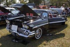 Impala negro de 1958 Chevy Imágenes de archivo libres de regalías