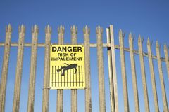 Impalement danger and risk sign on fence for security and protection royalty free stock images