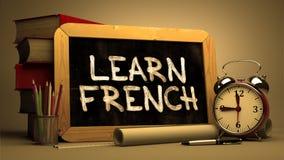 Impari il francese - citazione motivazionale sulla lavagna Immagine Stock