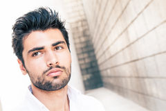 Impasse. Italian handsome man. Close style portrait. Outdoors. stock photography
