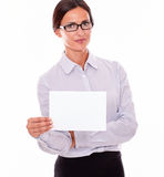Impassive brunette businesswoman with a signboard. Impassive brunette businesswoman with glasses, wearing her long hair tied back, and a button down shirt stock photography