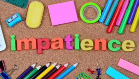 Impatience word on cork Royalty Free Stock Photography