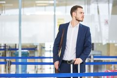 Impatient business man in the airport. Impatient business man in airport terminal on business waiting for departure stock photos